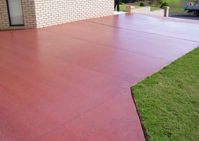 Decorative honing to existing driveway Kingaroy - Solvent acrylic + slip media casted in (2)