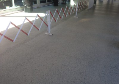 Honed Concrete Walkway - Brisbane International Airport. -Solvent Acylic Top Coat