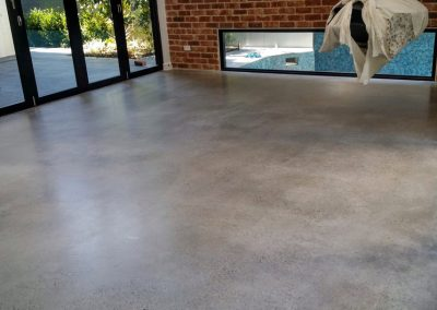 Commercial style polished concrete selected for this architectural designed home Newstead Brisbane
