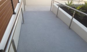 Access ramp ground then honed - sealed with natural look impregnating sealer to ensure slip rating requirement is achieved